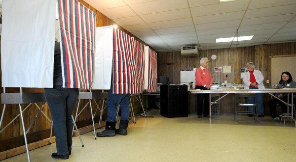 People vote at the WCR Hall in Macksburg, Iowa.