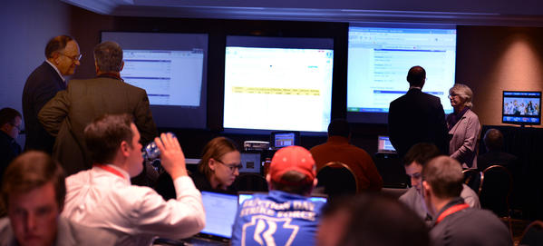 Republican staffers and volunteers who work for the Pa. Romney For President team monitor election results from districts across the state an hour after polls closed in a room known as the War Room in the Harrisburg Hilton Tuesday night. At left is Rob Gleason, Chairman, Pa. state Republican Party.