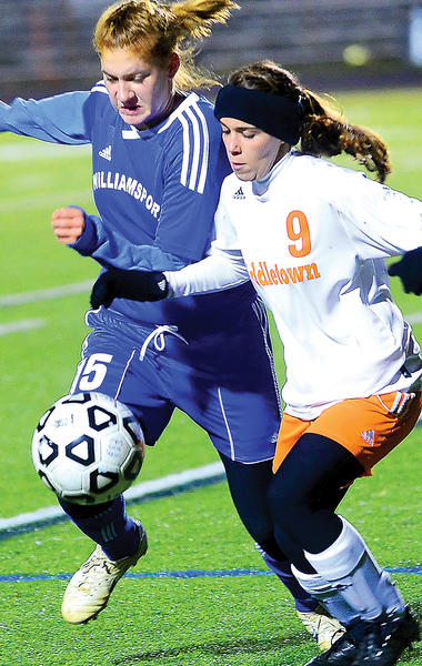 Williamsport's Lizzy Willis, left, tangles with Middletown's Mary-Kate Afzali, right, during the first half of Tuesday night's Maryland Class 2A West girls soccer final at Middletown.