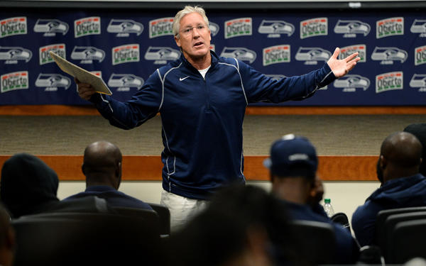 Seahawks head coach Pete Carroll rallies his players in the early morning during a team meeting at the practice facility in Seattle.