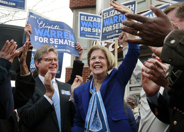 Democrat Elizabeth Warren waves to the crowd in Boston as Edward M. Kennedy, Jr., left, son of the late U.S. Sen. Edward M. Kennedy applauds during a campaign stop in the Senate race on Monday.