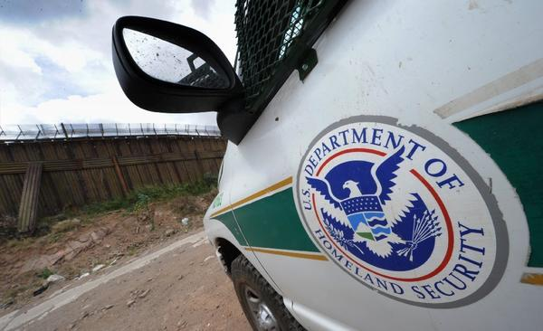 A U.S. Border Patrol vehicle keeps watch beside the fence that divides the U.S. from Mexico in Nogales, Arizona. The U.S. Supreme Court will decided whether its 2010 decision on immigrants' right to counsel should apply retroactively.
