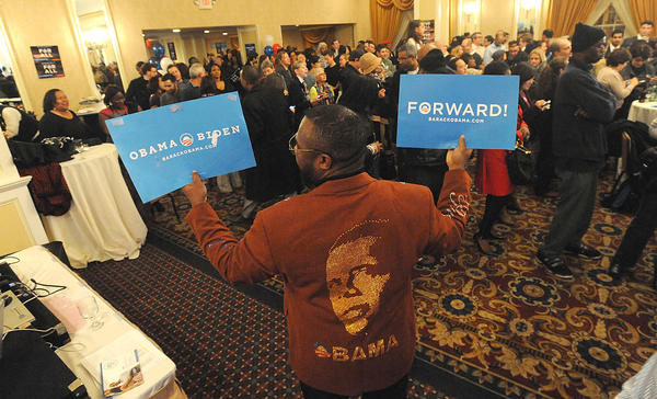 Simon Carr from Punchline Clothes from Philadelphia shows off his hand mad Obama jacket as the President Obama supporters, volunteers and community leaders gather at the Historic Radisson Plaza-Warwick Hotel in Philadelphia on election night, Tuesday.