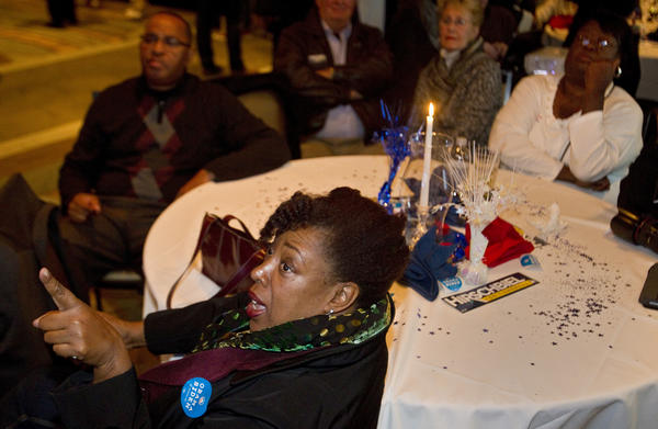 Keela Boose of Norfolk watches as election results begin to come in during an election night party for Paul Hirschbiel in Virginia Beach on Tuesday night.