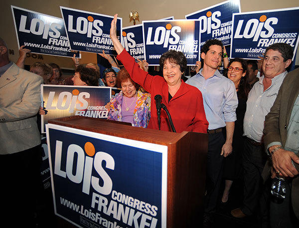 Democrat Lois Frankel greets her supporters as she takes the stage for her acceptance speech after winning Congressional District 22. On the right of Frankel is her son Ben Lubin.