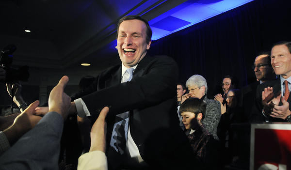 Chris Murphy acknowledges the crowd assembled in the Hartford Hilton ballroom after beating Linda McMahon for the U.S. Senate. At right is Gov. Dannel Malloy and U.S. Senator Richard Blumenthal.
