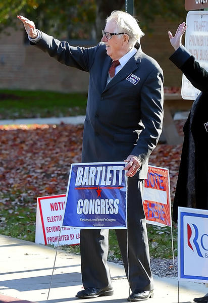Roscoe G. Bartlett waves to people coming to Northern Middle School Tuesday to vote.