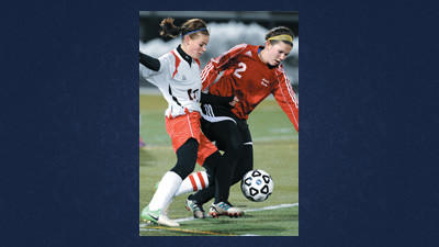 Danielle Wertz of Conemaugh Township battles with Molly Lennen of Sewickley Academy during a PIAA first round soccer playoff game Tuesday in Somerset.