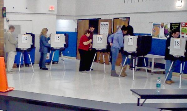 Voters occupy the bank of electronic voting machines at Westminster Elementary School on Tuesday, Nov. 6.