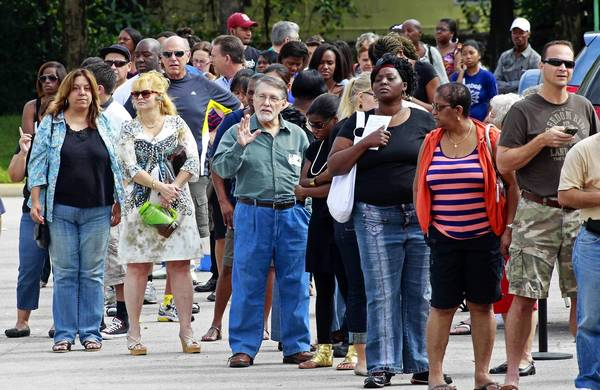 Long lines of voters are seen at the Supervisor of Elections office in West Palm Beach, Florida on Monday during early voting.