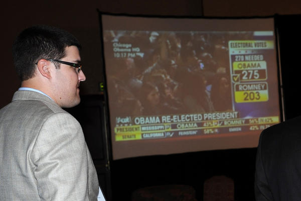 Republicans watch television at the Harrisburg Hilton ballroom Tuesday night after President Obama was re-elected.