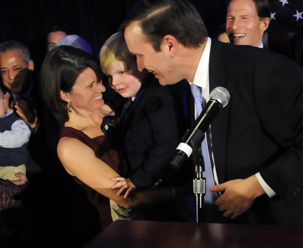 Chris Murphy hugs his wife Cathy Holahan and his son, Owen, 4 after giving his victory speech in the Hartford Hilton ballroom after beating Linda McMahon for the U.S. Senate.