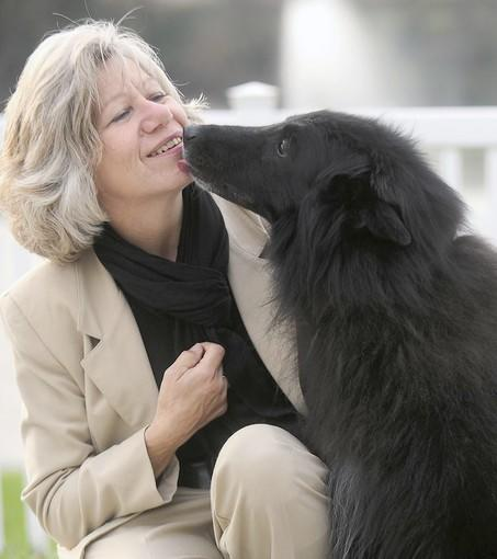 Sherry Hanley gets a kiss from her 12 year old Belgian Sheepdog, Eli. They are from the Lehigh Valley.
