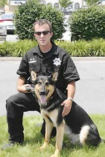"K-9 dog Jynx is shown with Berks County Deputy Sheriff Kyle Pagerly, who was killed in the line of duty June 29, 2011. Jynx is one of the dogs being honored in the ""Dog Hero Awards."""