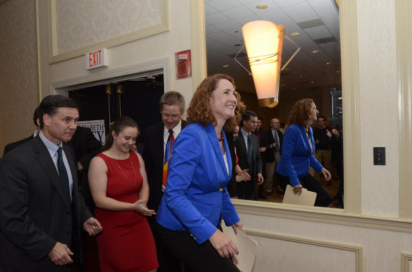 Elizabeth Esty enters Waterbury headquarters with husband Dan and family members as she claims victory in her fifth Congressional district race against Andrew Roraback Tuesday night.