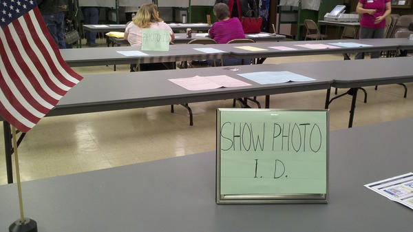 This sign asking voters to show their photo IDs was on display at the polling place in State Line, Pa.