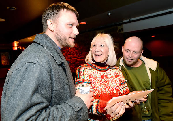 Hagerstown mayoral candidate David Gysberts, left, reacts to early voting results with supporters Caroline Orner, center, and Michael Jones, right, Tuesday night at SPIN in downtown Hagerstown.