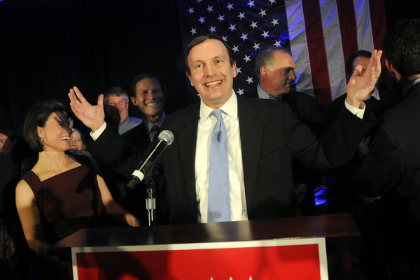 Chris Murphy acknowledges the crowd assembled in the Hartford Hilton ballroom after beating Linda McMahon for the U.S. Senate. His wife Cathy Holahan is at left and U.S. Senator Richard Blumenthal is next to her.