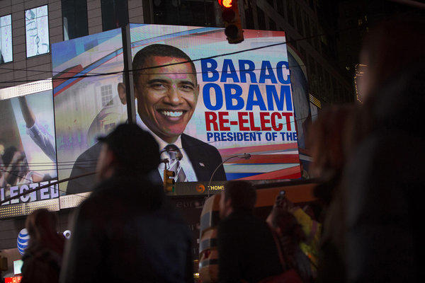People celebrate the news that President Barack Obama has won re-election at Times Square in New York.