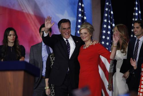 GOP presidential challenger Mitt Romney and wife Ann wave to supporters at the Boston Convention Center.