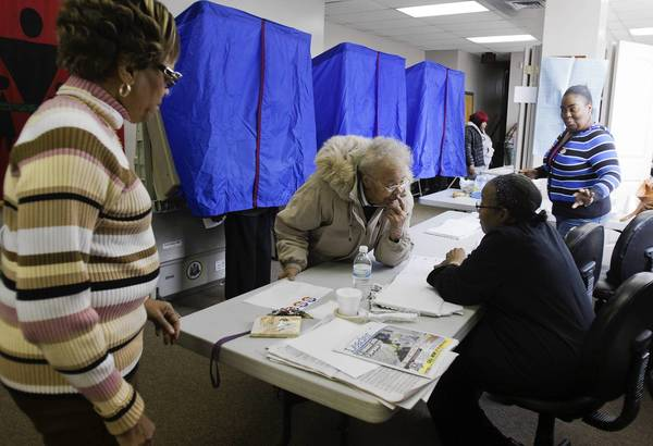 A voter checks in at her polling place in North Philadelphia. Pennsylvania was the site of some of the most widely reported problems.