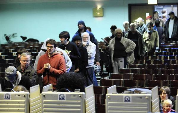 Voters lline up at Kozminski Community Academy in the Hyde Park neighborhood on Tuesday.