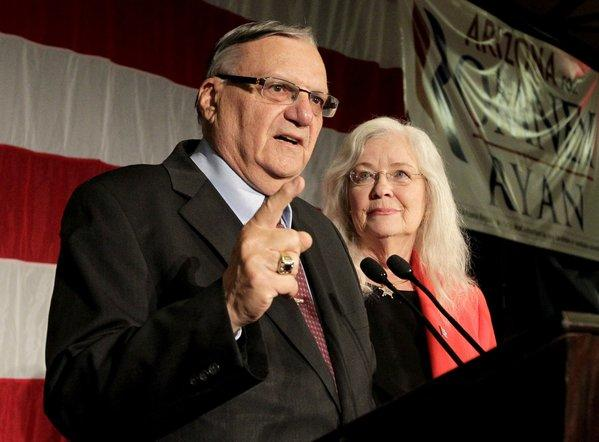 Maricopa County Sheriff Joe Arpaio with his wife, Eva, speaks to supporters during an election night party in Phoenix.