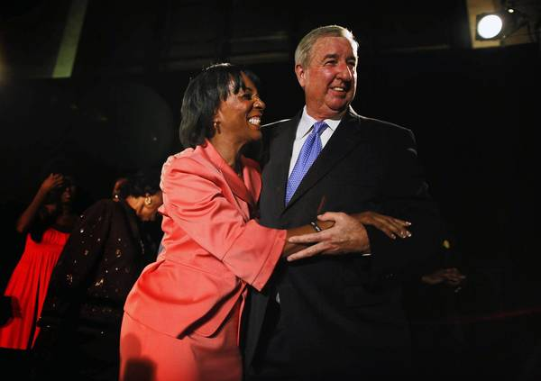 Jackie Lacey, candidate for Los Angeles County district attorney, gets a hug from her boss, Dist. Atty. Steve Cooley, who is retiring after a historic three terms. Lacey was leading in early returns.