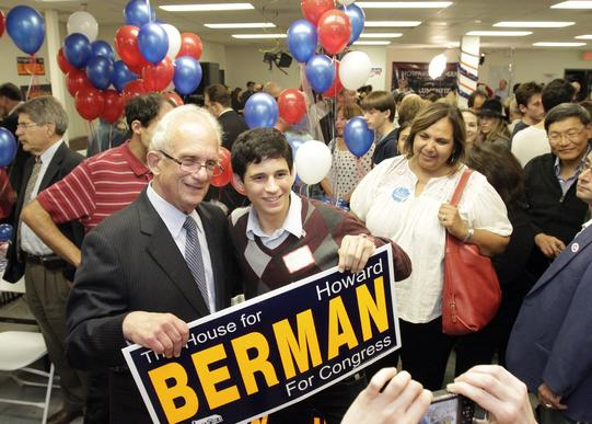 Democratic Congressman Howard Berman has a picture taken with supporter Eytan Wallace during an election night party at his campaign headquarters in Encino.