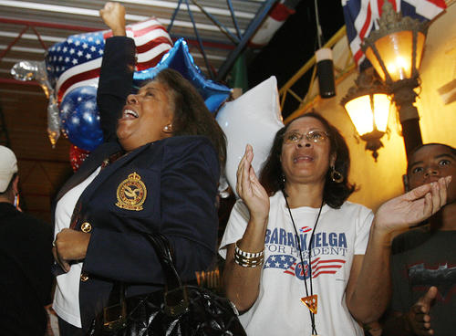 Pamela Wilson, of Tuluca Lake, and Helga Kuhn, of South Pasadena, celebrate the announcement of President Barack Obama being re-elected to his second term as President of the United States at a Democrat Party celebration at Burger Continental in Pasadena on Tuesday, November 6, 2012.