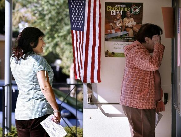 Flor Hernandez, 57 of Glendale, left, came ready to vote at the Glendale Community Church of God in Glendale on Tuesday, Nov. 6, 2012.