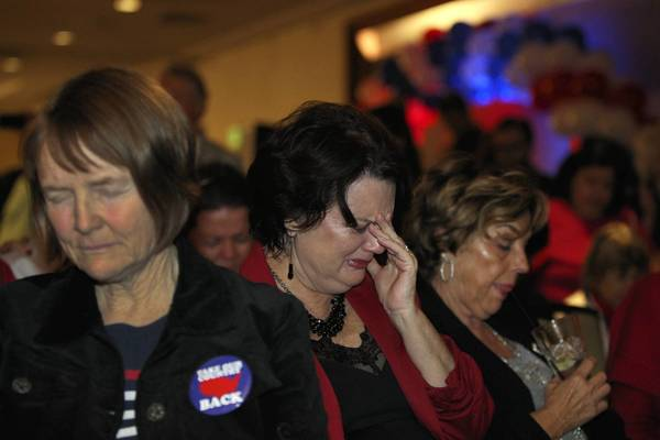 California supporters Carole Cole, left, and Karen Jerpseth, center, react to news of Mitt Romney's loss at a Republican election night party in Costa Mesa.