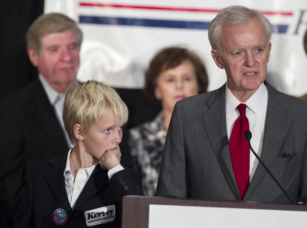 Watched by his son Henry, Democratic Senate candidate Bob Kerrey delivers his concession speech at the Nebraska Democratic Party's election night gathering in La Vista.