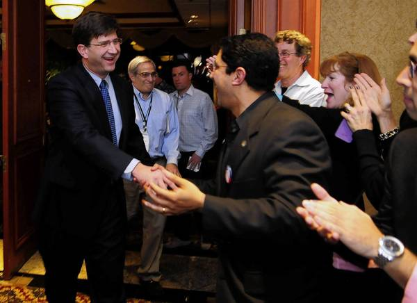 Brad Schneider enters the room to cheers after being announced the winner during his election night party at the Hilton Hotel in Northbrook.