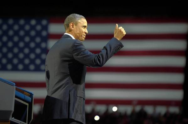 President Obama acknowledges supporters at an election night rally at McCormick Place in Chicago. His victory speech summoned some of the poetic flourish of 2008.
