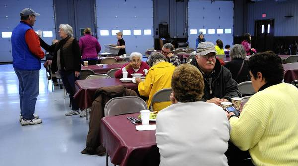 People weary from power outages from Hurricane Sandy gather for a hot lunch in the Riegelsville Fire Department social hall Friday.