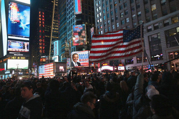 Supporters of President Barrack Obama celebrate in Times Square as television networks call the election in favor of President Barack Obama on November 6, 2012 in New York City.