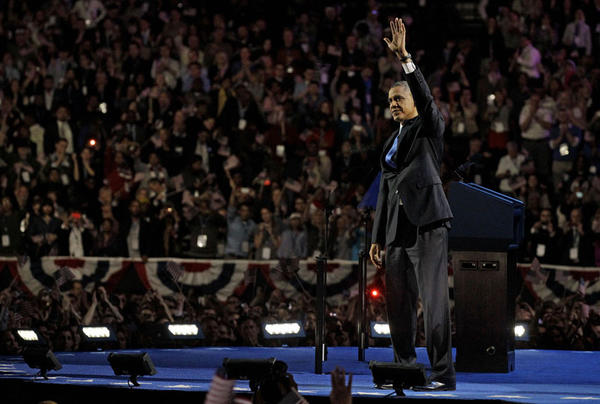 President Barack Obama waves to the crowd at his election night party Wednesday, Nov. 7, 2012, in Chicago. President Obama defeated Republican challenger former Massachusetts Gov. Mitt Romney.