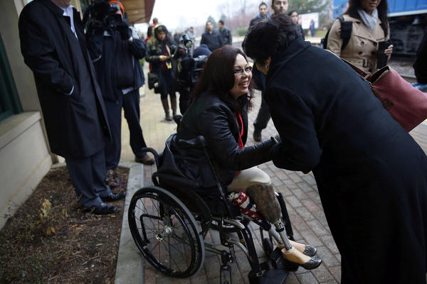 Congresswoman-elect Tammy Duckworth, 8th Congressional District, greets commuters at the train station in Schaumburg.