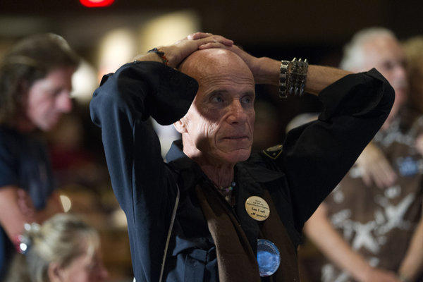 Dennis Eugene Hatton reacts while watching televised reports on the presidential election at an Obama watch party in Fort Myers, Fla.