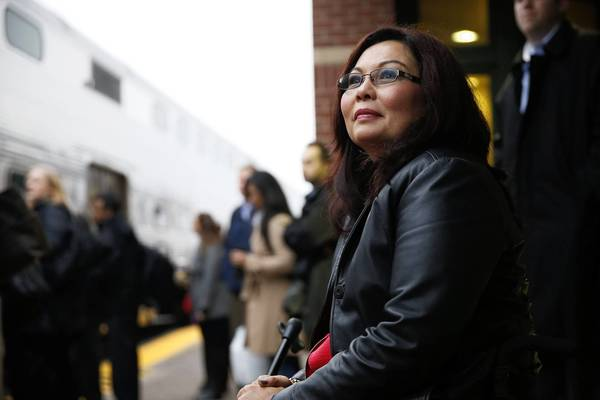 Congresswoman-Elect Tammy Duckworth, 8th Congressional District, waits to greet commuters at the train station in Schaumburg. Duckworth, an Iraq War veteran who lost both legs in combat before turning to politics, defeated freshman Republican Rep. Joe Walsh