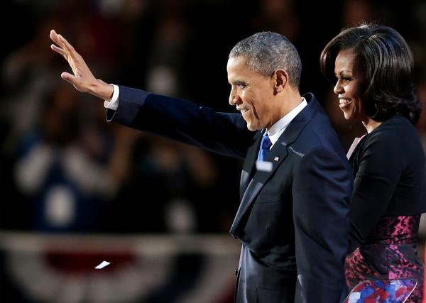President Obama stands on stage with first lady Michelle Obama after his victory speech on election night at McCormick Place in Chicago Tuesday.