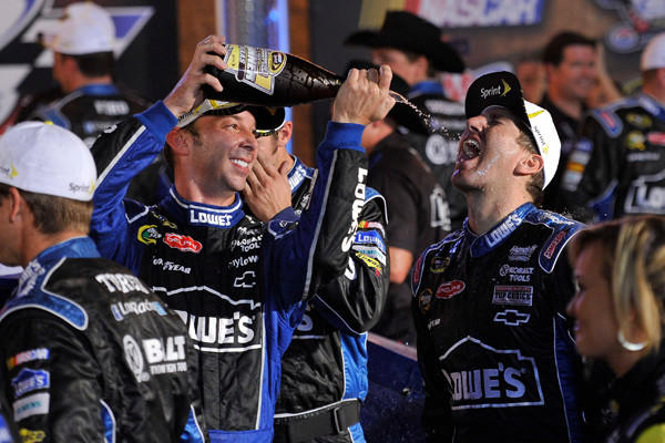 Sprint Cup Series driver Jimmie Johnson (48) crew chief Chad Knaus celebrates the win at AAA Texas 500 at Texas Motor Speedway on Nov. 4.