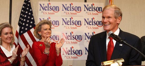 Sen. Bill Nelson celebrates with his wife Grace, and daughter Nan Ellen Nelson, at his campaign party, in Orlando, Fla., Tuesday night, November 6, 2012.