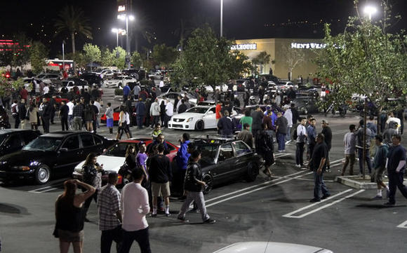 It took several hours Tuesday night to fully disperse a huge crowd of car enthusiasts from the Empire Center in Burbank.