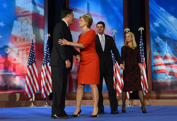 Presidential candidate Mitt Romney and his wife Ann stand on stage with Paul Ryan and wife Janna after Romney conceded defeat to President Obama.