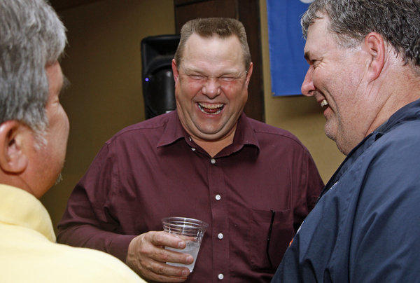 Sen. Jon Tester, center, is greeted by supporters during an election-night party in Great Falls, Mont.