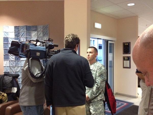 Staff sergeant Michael Merritt, a radiologist from Canton, Conn., is interviewed by a Connecticut TV station during the UConn basketball team's visit to Landstuhl militray hospital.