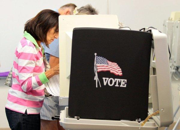 Voter in Palm Desert casts a ballot; women's votes have become influential and even decisive in recent elections.