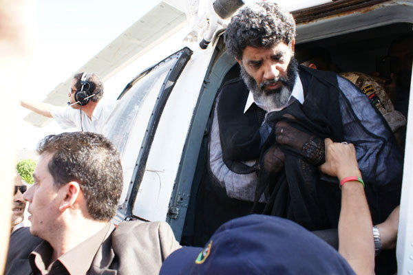 Muammar Gaddafi's former spy chief Abdullah al-Senussi (R) arrives in Tripoli September 5, 2012.